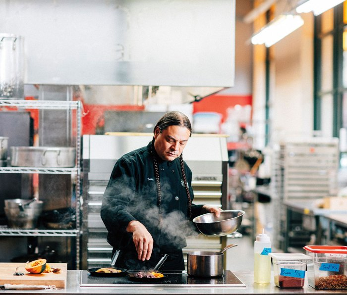 Sean Sherman, cooking at the Indigenous Food Lab in Midtown Global Market, plans to open a new downtown restaurant, Owamni by The Sioux Chef this spring.