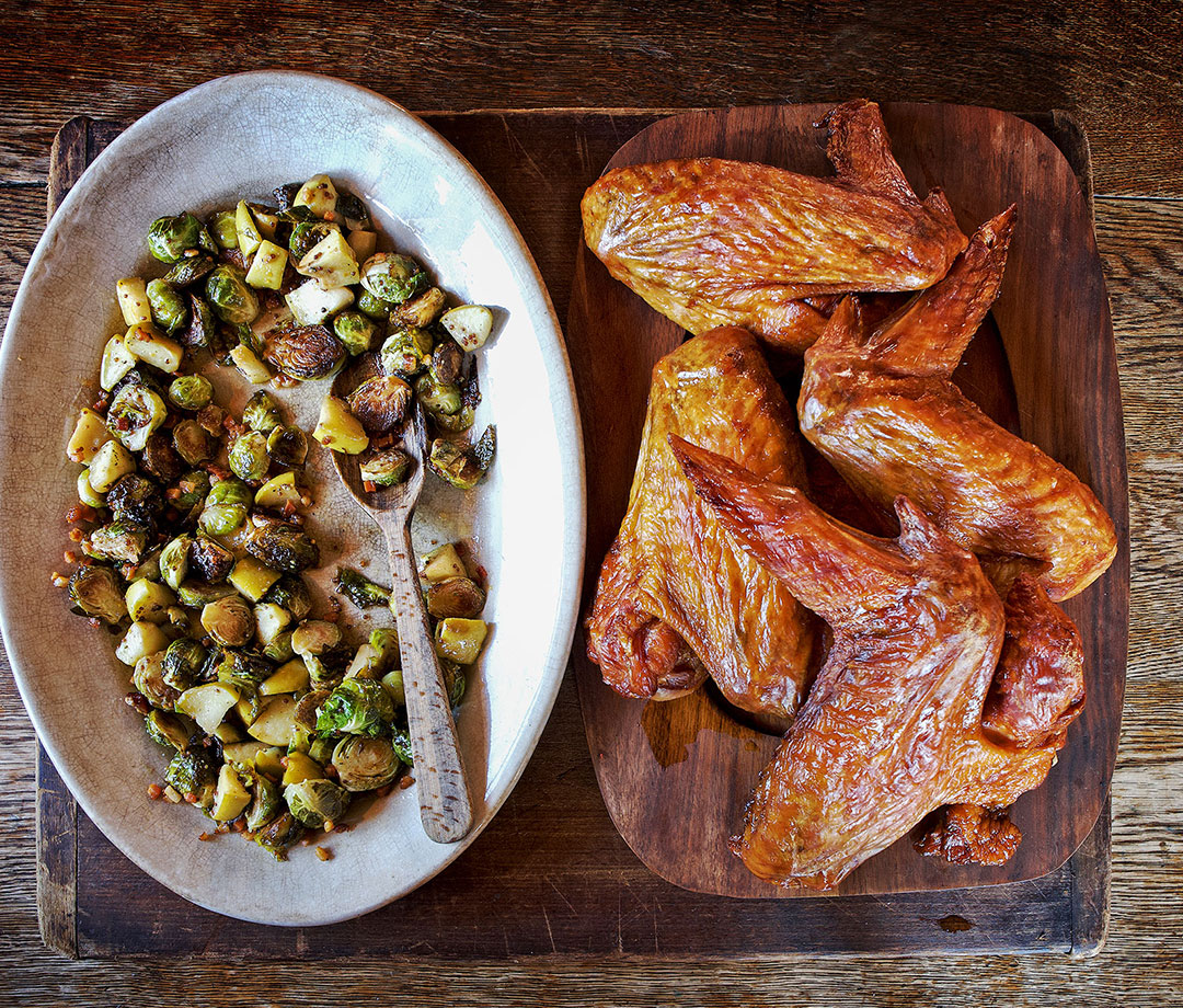 Smoked Turkey Wings Over Bacon Brussels Sprouts