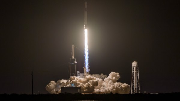 SpaceX Falcon 9 rocket with Crew Dragon capsule lifts off from the Kennedy Space Center.