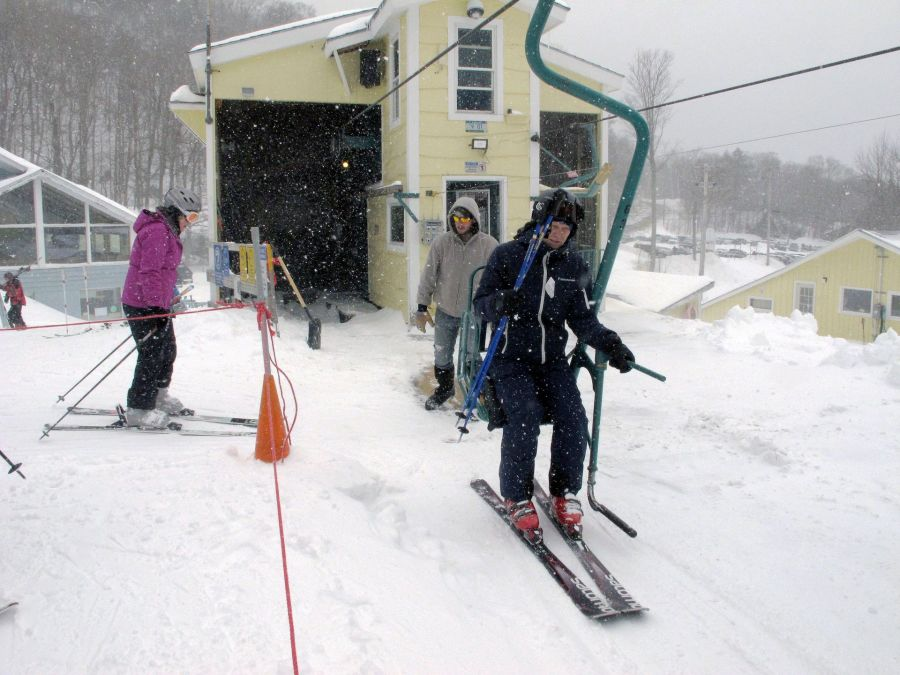 Skiers board the chairlift at Mad River Glen in Fayston, Vt