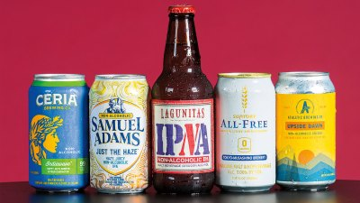 Lineup of nonalcoholic beers. From left: Ceria Brewing Company Grainwave, Samuel Adams Just the Haze IPA, Lagunitas Brewing Company IPNA, Suntory All-Free, and Athletic Brewing Company Upside Dawn Golden Ale