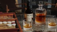 Decanter, rocks glasses, and bottle of rare Buffalo Trace whiskey that's been aging since 1980