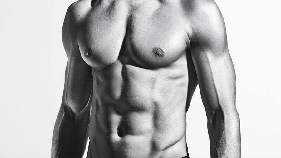 Black and white portrait of muscular male torso with six-pack abs