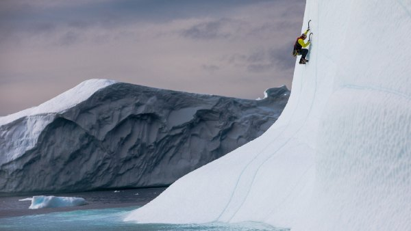 WIll Gadd climbing an iceberg near Ilulissat, Greenland on August 27, 2018.