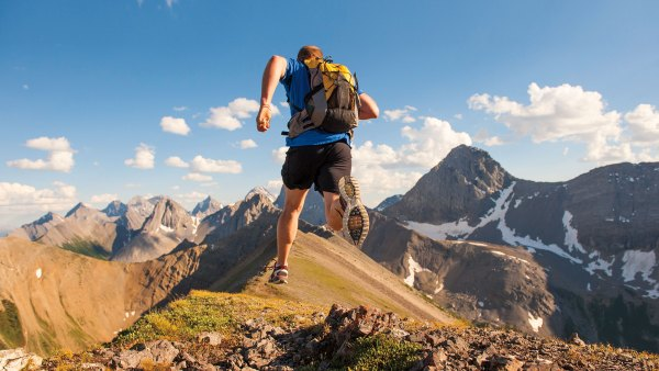 Man running up mountain