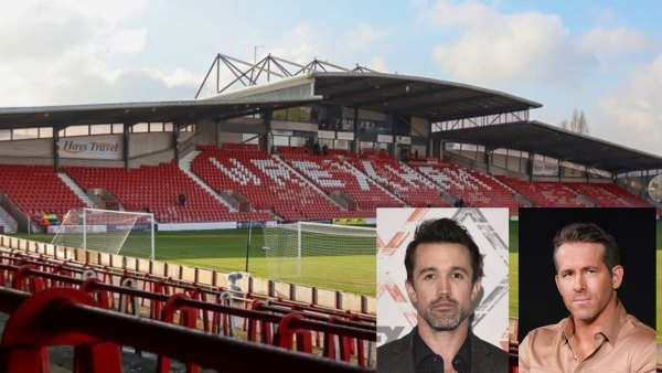 Image of Wrexham stadium in Wales with actors Ryan Reynolds and Rob McElhenney