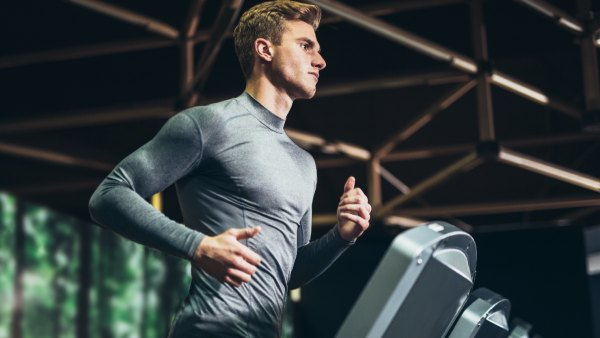 Man running indoors on treadmill