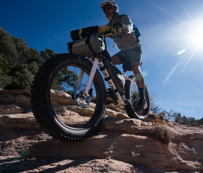 Mountain biker crossing rocky terrain in Bears Ears National Monument