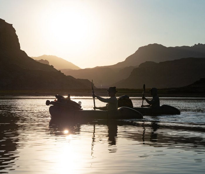 Paddling loaded packrafts on Lake Powell.
