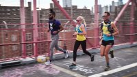 Knox Robinson, Jason Schlarb, and Meredith Edwards run across the Manhattan Bridge