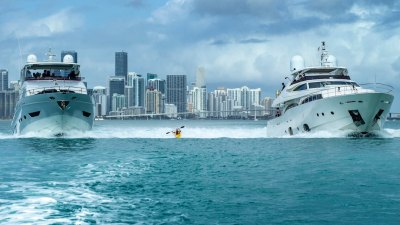 Dane Jackson kayak surfing the dual wake of two yachts in Miami