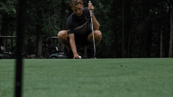 Man setting up for putt