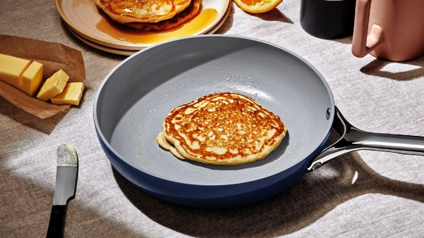 Cooking pancakes in navy Caraway Cookware Set