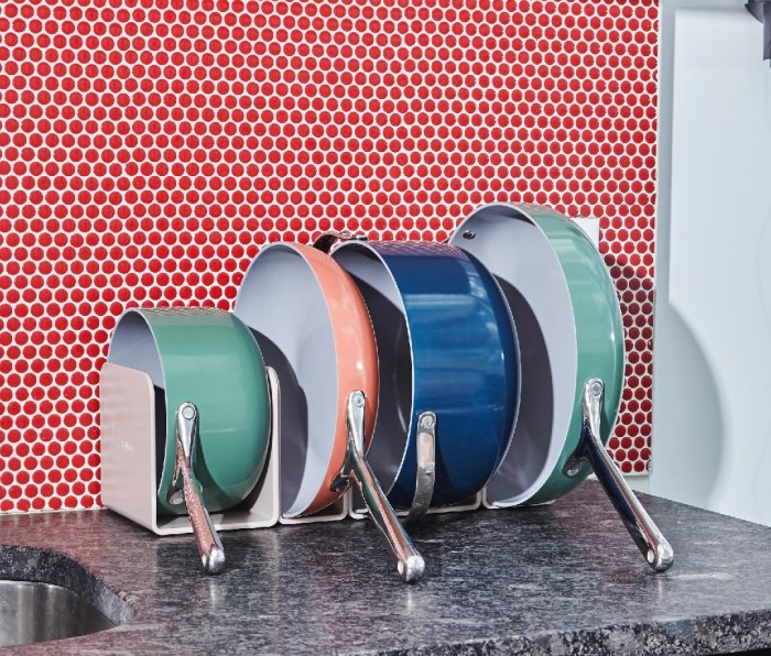 Caraway Cookware Set in magnetic storage system (seen in Sage, Perracotta, and Navy)