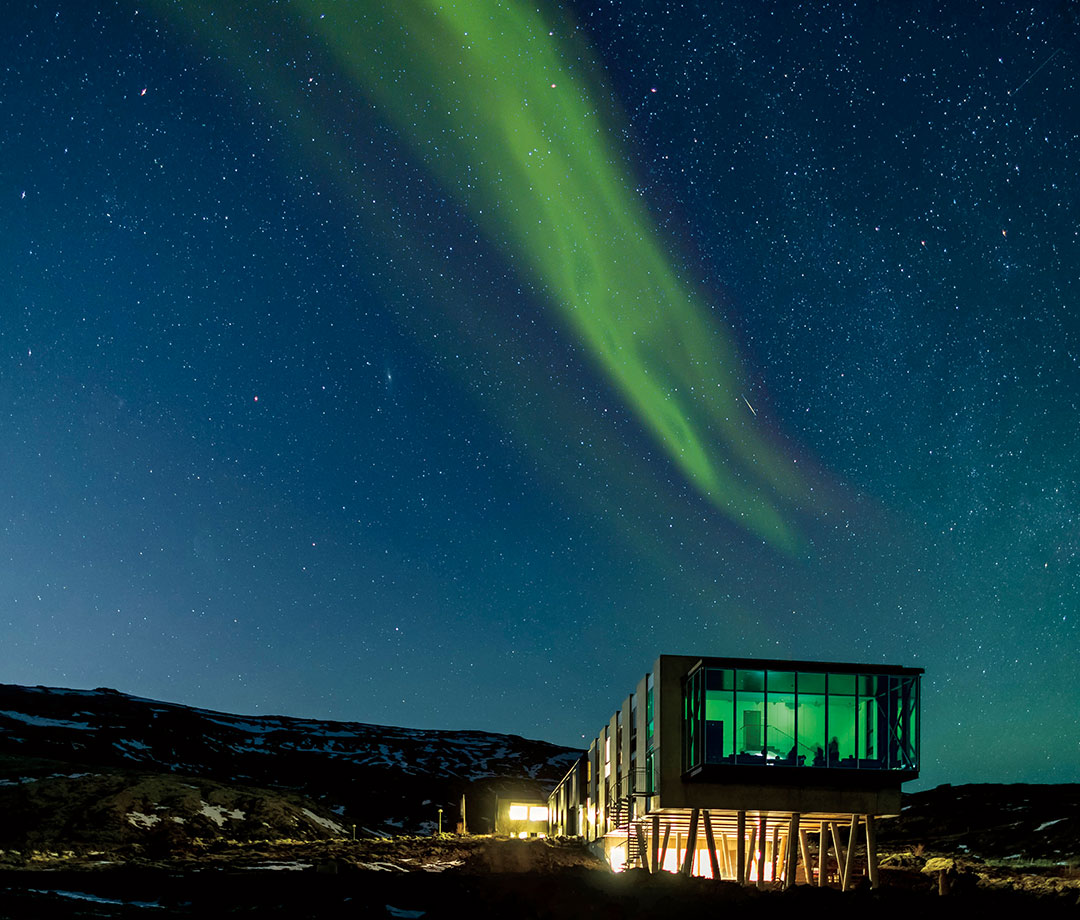 Iceland's Northern Lights Bar at night with aurora borealis overhead