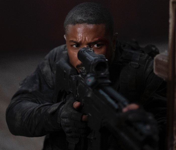 Actor Michael B. Jordan holding a rifle as a Navy SEAL in movie 'Without Remorse'