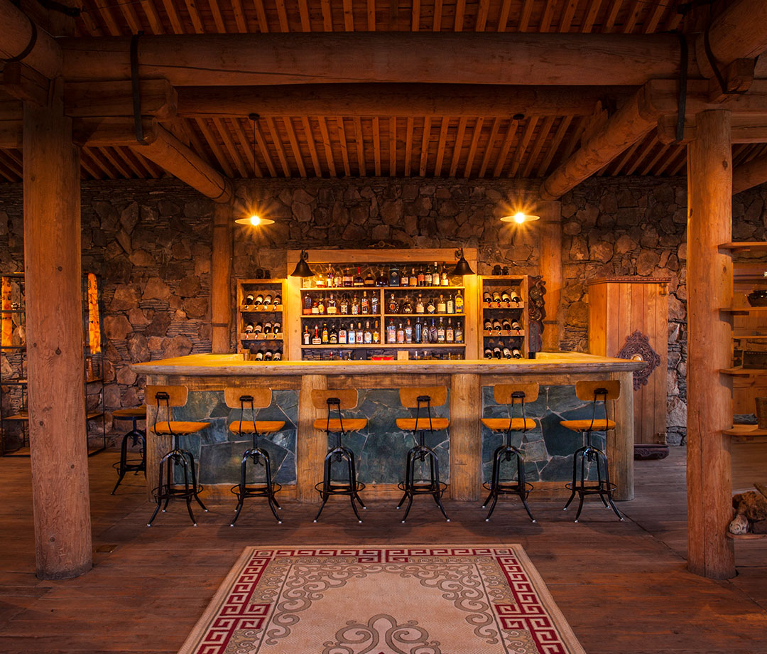 Interior of stone-and-wood bar called The Thirsty Camel in Mongolia