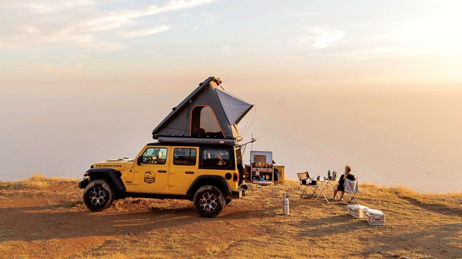 Family camping on the beach in San Francisco with Cypress Overland Jeep Wrangler Rubicon, which includes an electric Engel fridge and kitchen