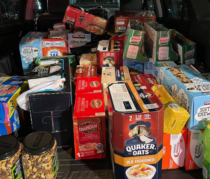 Car trunk filled with endurance fuel like Quaker Oats, granola a\bars, and nuts