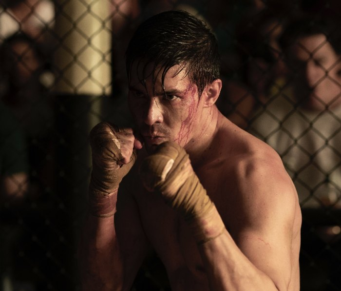 Lewis Tan stands shirtless in a fighting stance as Cole Young in 'Mortal Kombat'