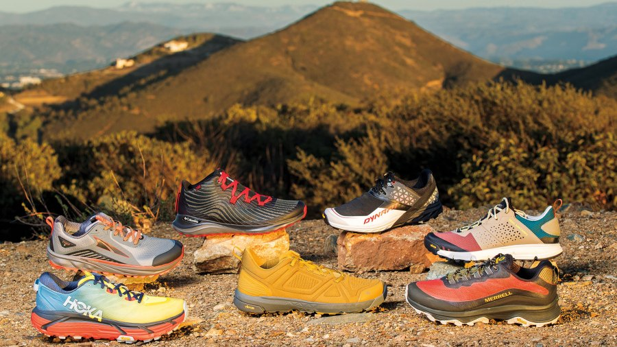 Trail running shoes in foreground with mountain in background