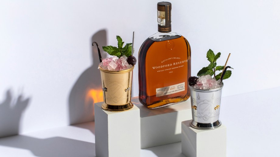 Bottle of Woodford Reserve Kentucky Straight Bourbon and two glasses of 2021 Kentucky Derby mint julep