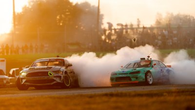 Formula DRIFT cars racing with smoke coming off tires
