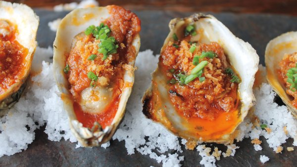 Closeup of grilled oysters with spicy nduja butter