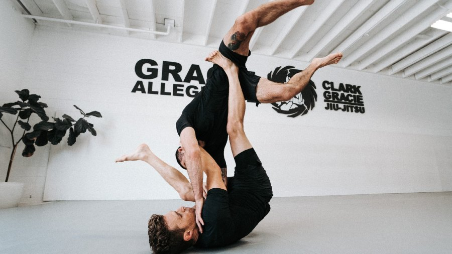Two martial arts fighters grappling