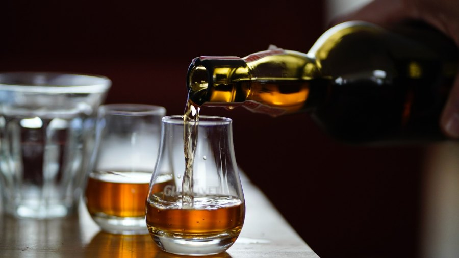 Pouring whiskey in a glass