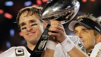 New Orleans Saints quarterback Drew Brees (9) celebrating with the Vince Lombardi Trophy after the Saints' 31-17 win over the Indianapolis Colts in the NFL Super Bowl XLIV football game in Miami.