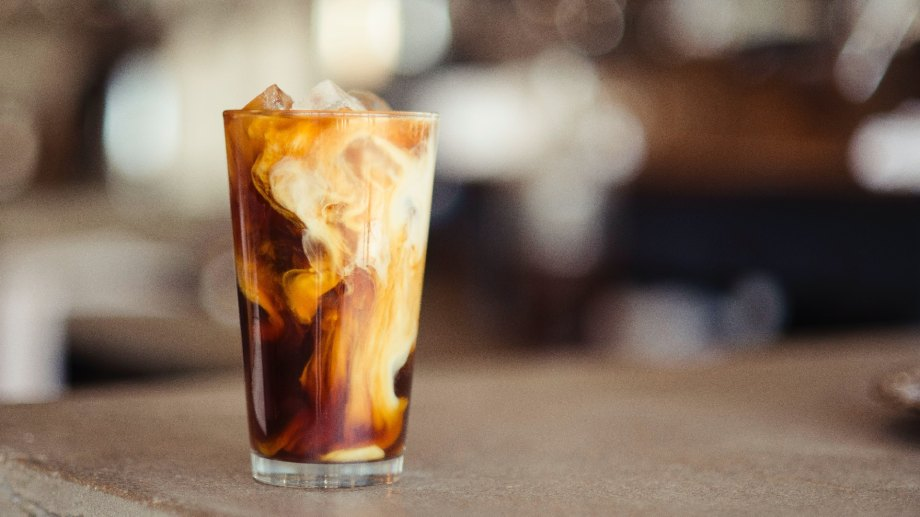 Iced latte in a glass cup with milk