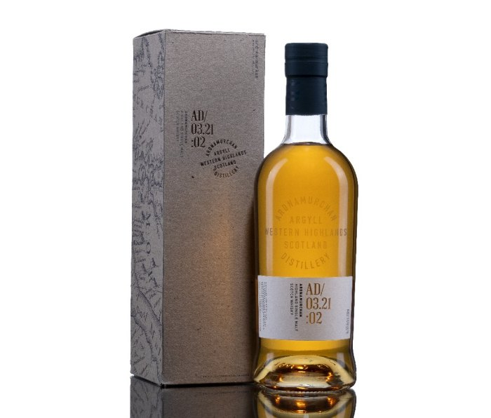 A box for Ardnamurchan Small Batch AD/03.21:01 scotch, standing next to a full bottle.