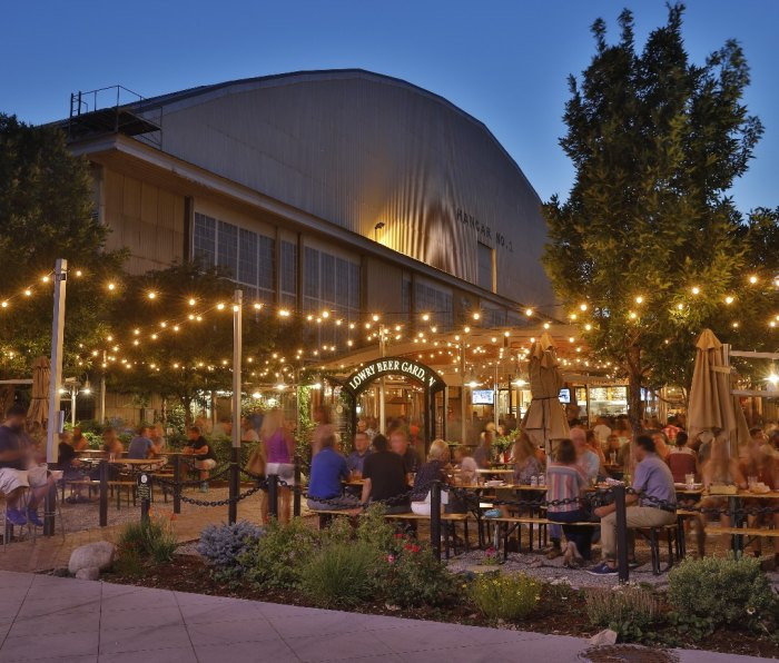 Housed in a revamped airplane hangar on a former Air Force base, the Oktoberfest-inspired Lowry Beer Garden is actually set in its very own park.