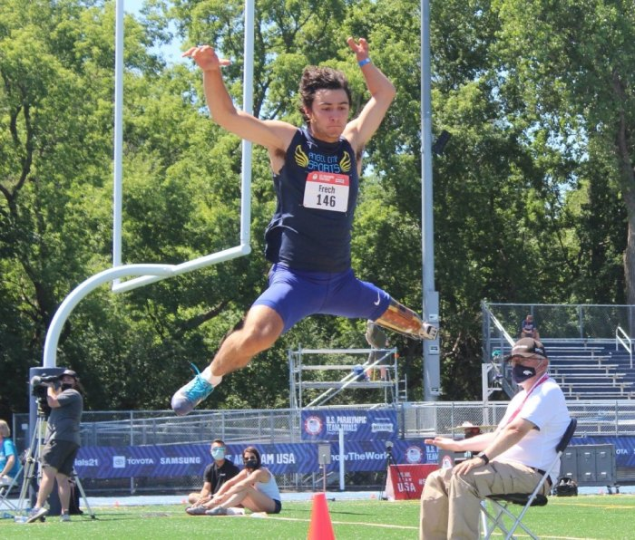 Ezra Frech competing in long jump
