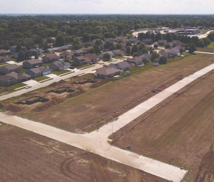 A view from the air of new development in Newton, Iowa with several homes under construction.