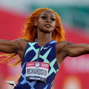 Sha'Carri Richardson celebrates after winning the fourth heat during the women's 100-meter run at the U.S. Olympic Track and Field Trials, in Eugene, Oregon.