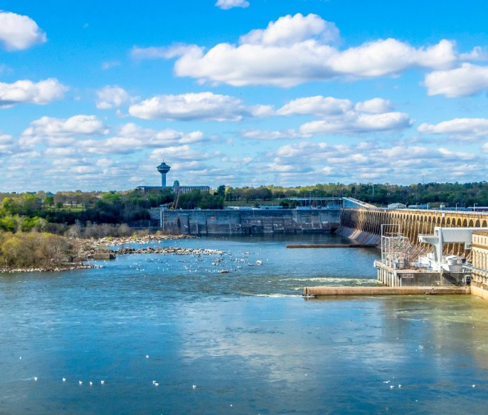 A view across the Tennessee River to the city of Muscle Shoals, Alabama. A large dam is on the right.