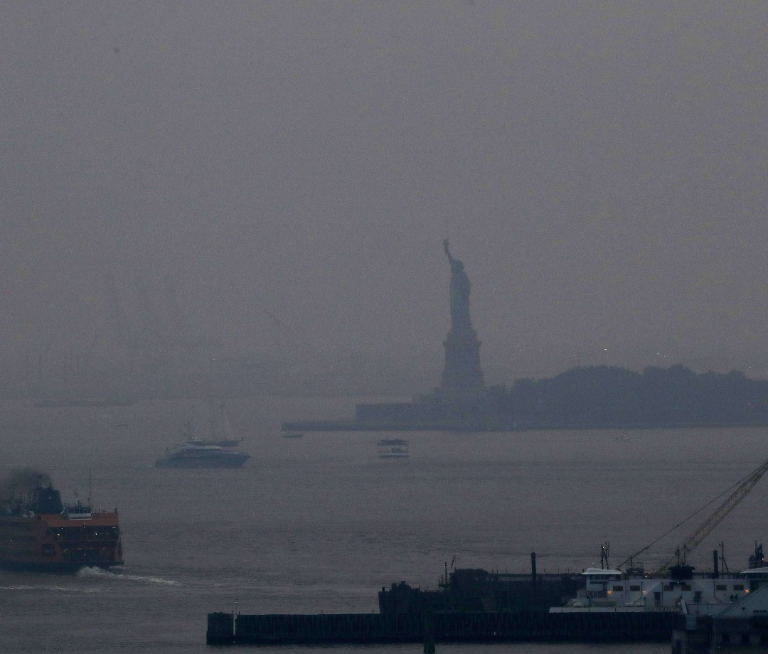 The Statue of Liberty shrouded in smoke from western U.S. wildfires.