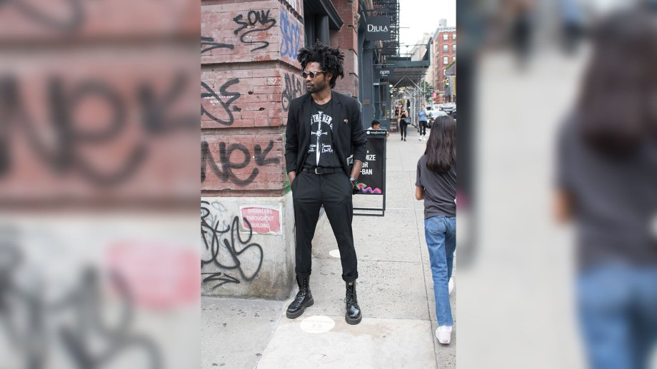Man on streets of New York City showing off street style