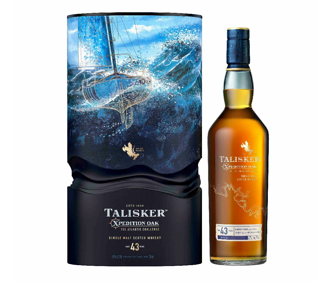 A box for Talisker 43-Year-Old Xpedition Oak: The Atlantic Challenge with the ocean and a sailboat pictures, alongside a bottle of the whisky.