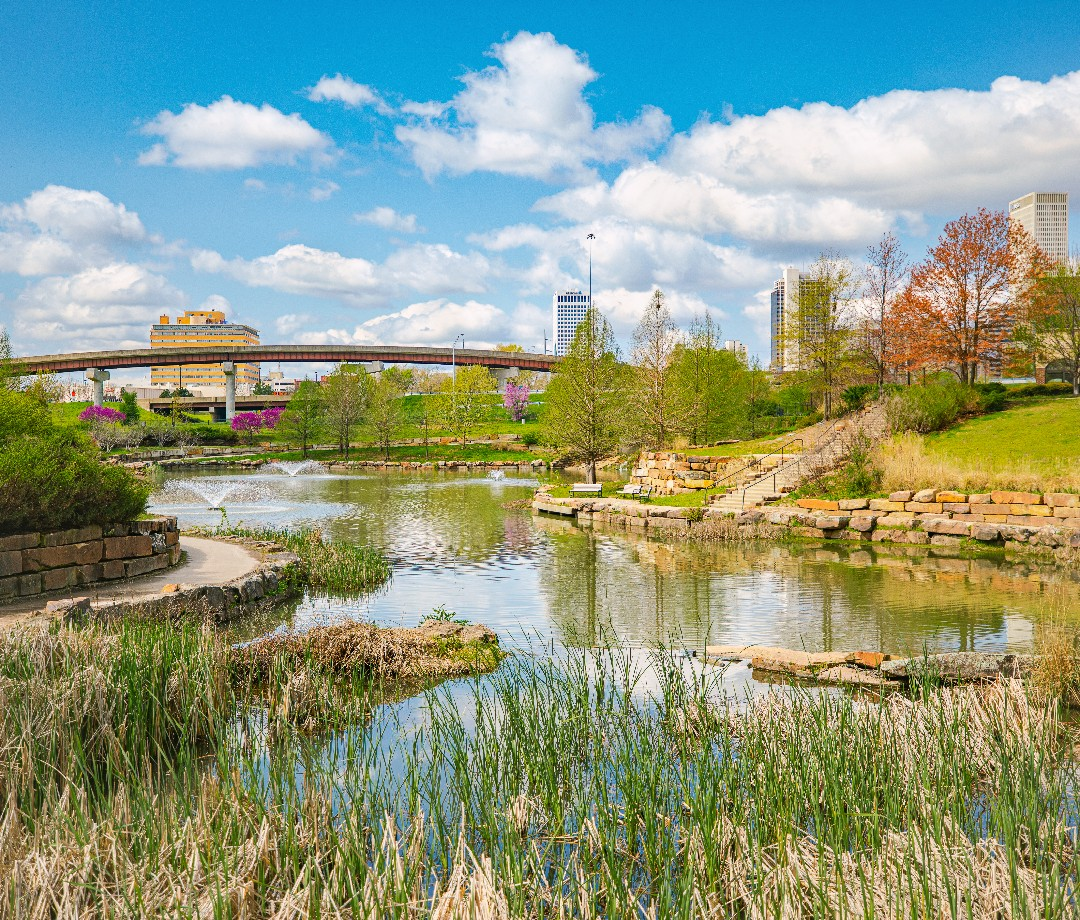 A view from Centennial Park in Tulsa with the city's skyline in the distance.