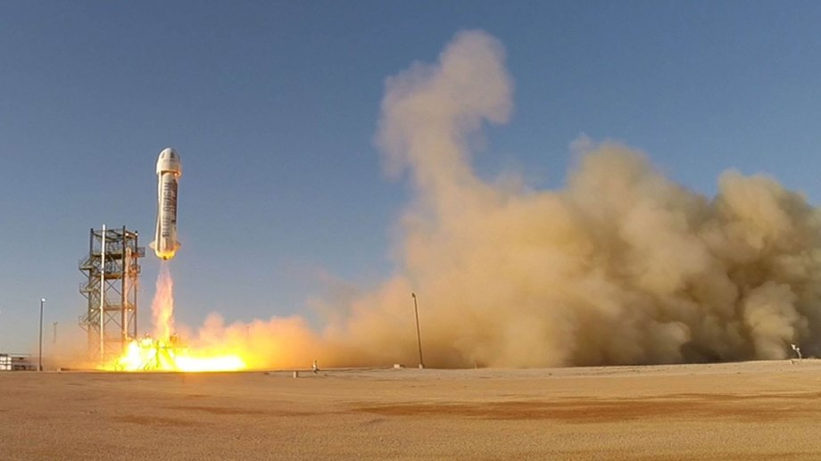 A test flight for Blue Origin's New Shepard suborbital launch system blasts off from West Texas.