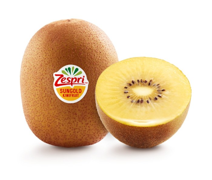Two SunGold kiwis. One is cut in half, showing a yellow interior. The other has a Zespri sticker on it.