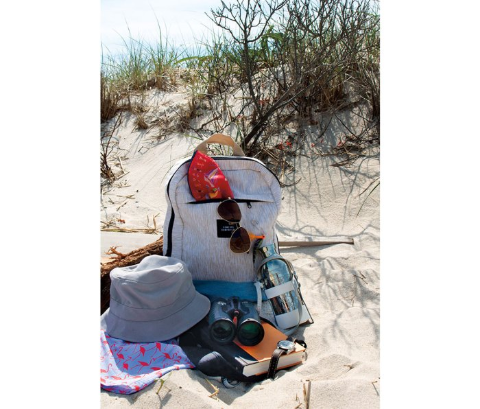 Backpack with bucket hat, sunglasses, and binoculars