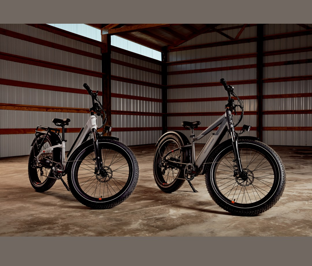 Two electric fat bikes in garage