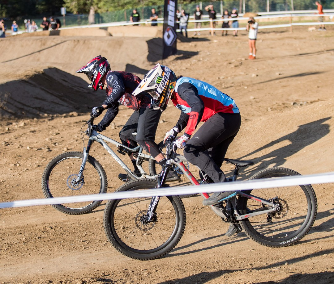 Two bike racers on the track.
