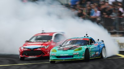 Cars racing close together at the Formula DRIFT race at Evergreen Speedway in Monroe, Washington.