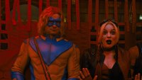Flula Borg as Javelin with Margot Robbie's Harley Quinn in 'The Suicide Squad'
