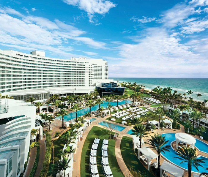 A view of the pool area, ocean, and the Fontainebleau Hotel in Miami Beach, Florida.